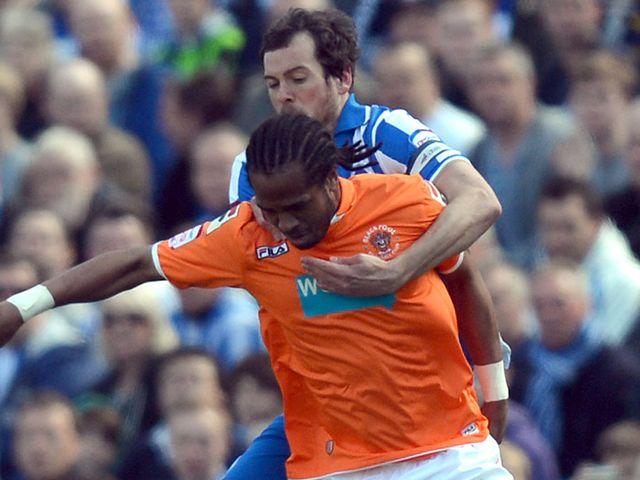 Nathan Delfouneso and Brighton's Will Buckley compete