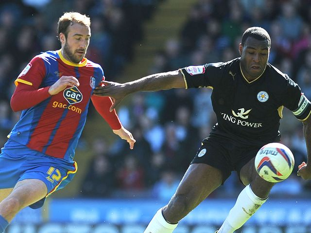 Glenn Murray of Crystal Palace looks to get past Wes Morgan