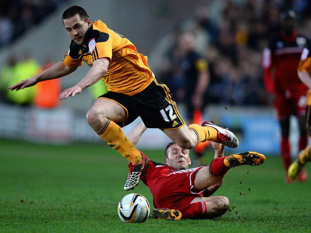 Hull's Matty Fryatt avoids Liam Kelly