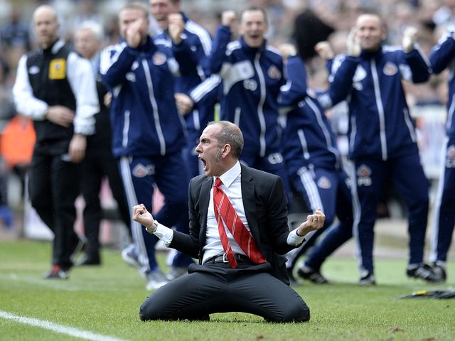 Paulo Di Canio slides on his knees to celebrate the second goal