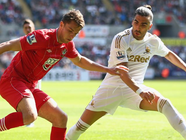 Chico Flores of Swansea tracks Southampton striker Jay Rodriguez.