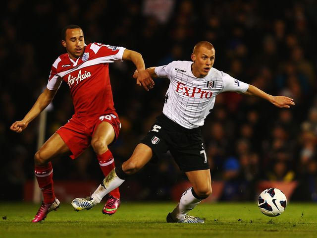 Andros Townsend and Steve Sidwell tangle.
