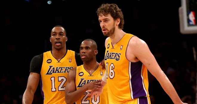 Dwight Howard, Jodie Meeks and Pau Gasol celebrate for the LA Lakers