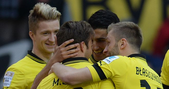 Marco Reus is mobbed after netting the opener