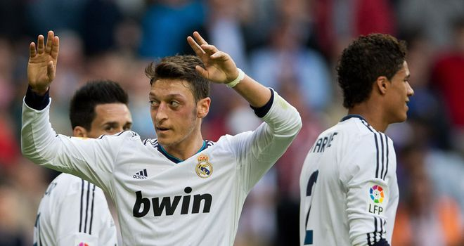 Mesut Ozil celebrates his second goal