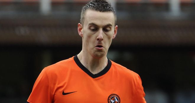 Rory Boulding's last-gasp winner sent Dundee United into the top half of the SPL table