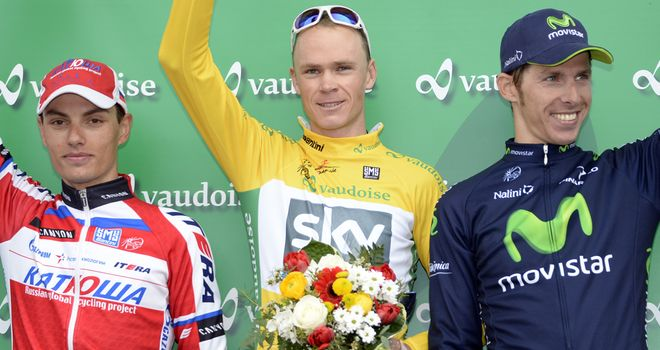 Chris Froome claimed overall victory ahead of Simon Spilak, left, and Rui Costa, right