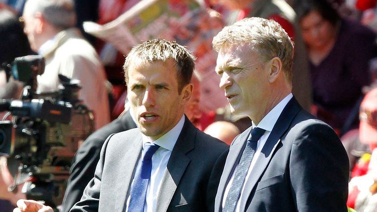 Phil Neville (left) set to renew acquaintance with David Moyes - and Manchester United