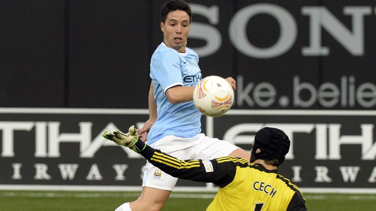 Samir Nasri scores for Manchester City in their 5-3 victory over Chelsea in New York