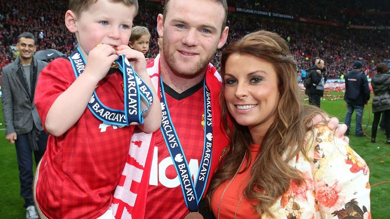 Wayne and Colleen Rooney on the Old Trafford pitch