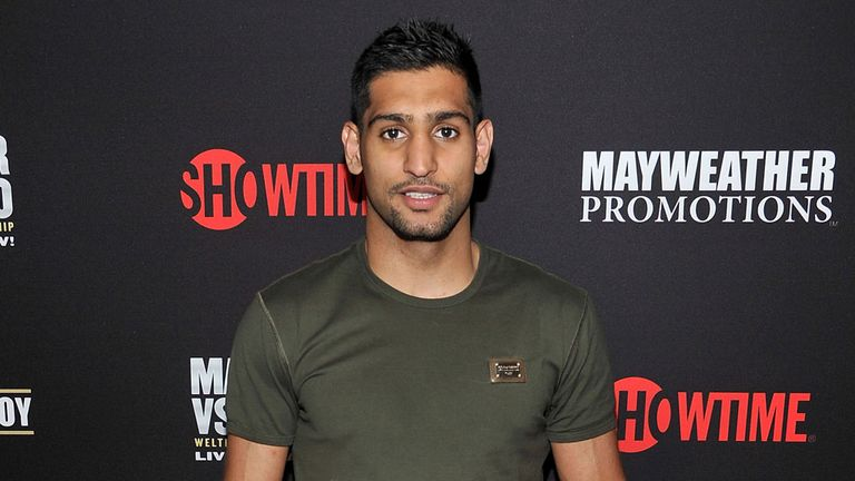 Amir Khan could be the next fighter who tries to take Floyd Mayweather's unbeaten record