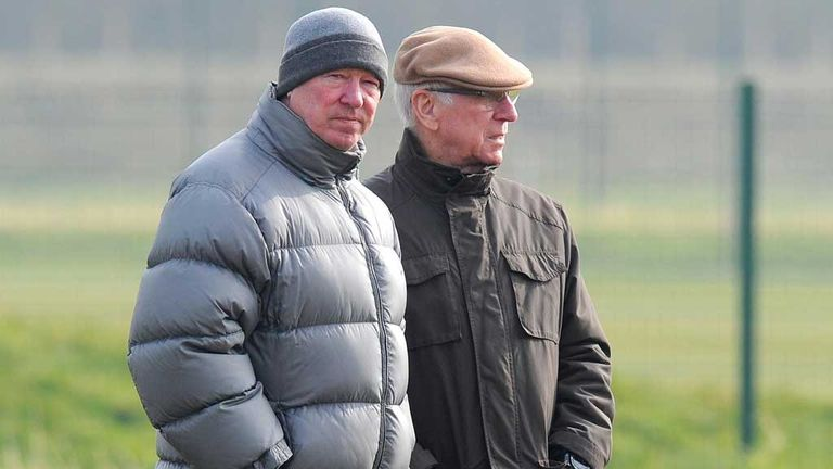 Sir Alex Ferguson and Sir Bobby Charlton watch a Manchester United training session