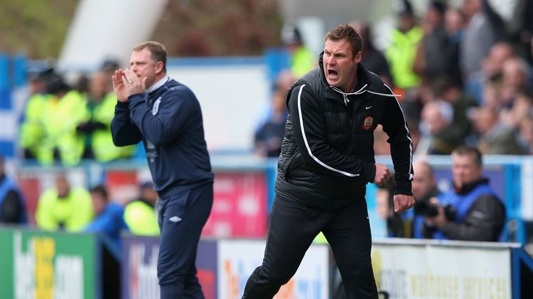 Mark Robins (L) praise for match-winner James Vaughan