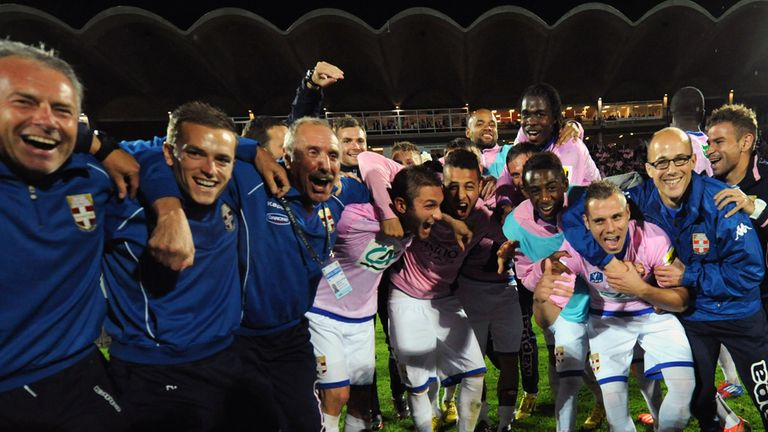 Evian's players and staff celebrate.