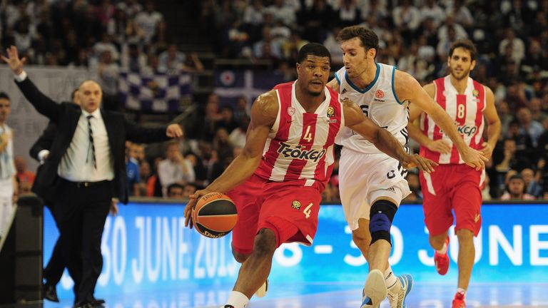 Olympiacos' Kyle Hines dribbles away from Rudy Fernandez of Real Madrid