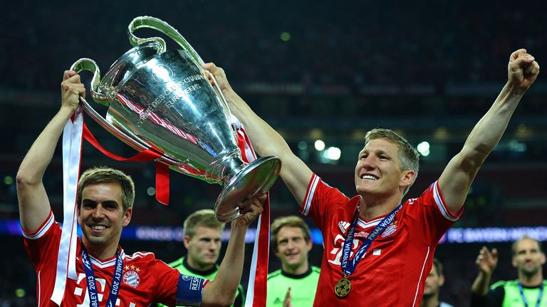 Philipp Lahm (left) and Schweinsteiger celebrated the 2013 Champions League