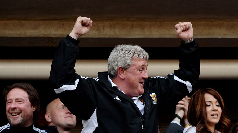Steve Bruce: Celebrates as Hull secure promotion