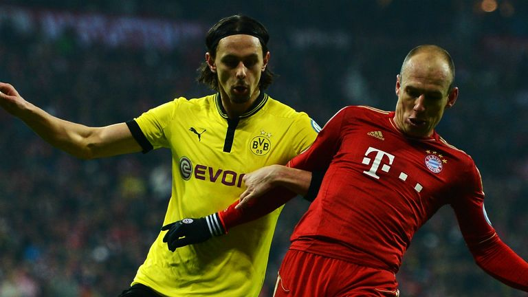 Neven Subotic locks horns with Arjen Robben earlier in the season