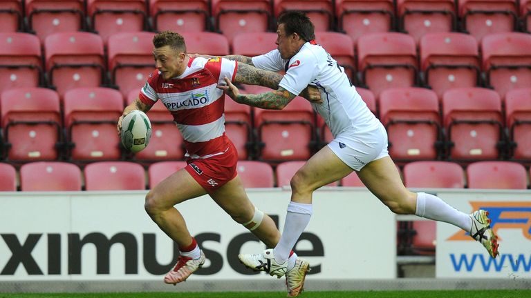 Josh Charnley charges over for a Wigan try