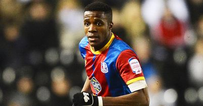 Zaha return down to United