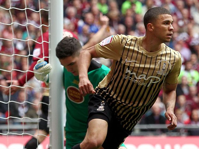 Nahki Wells: Wheels away after scoring Bradford's third goal