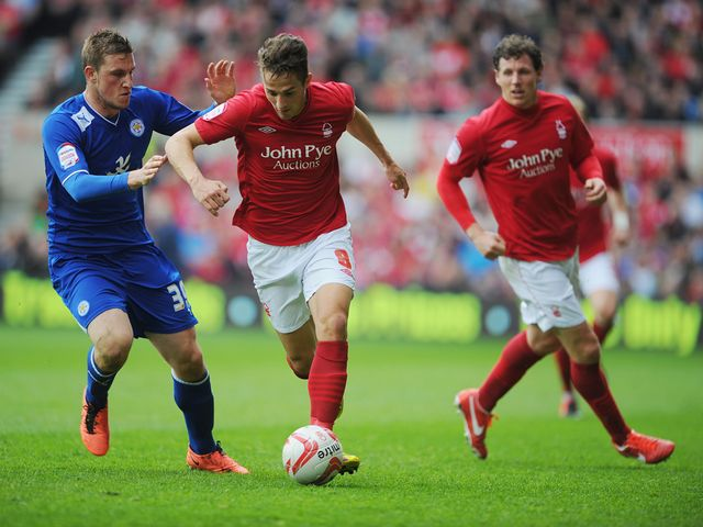 Chris Cohen is tackled by Chris Wood.
