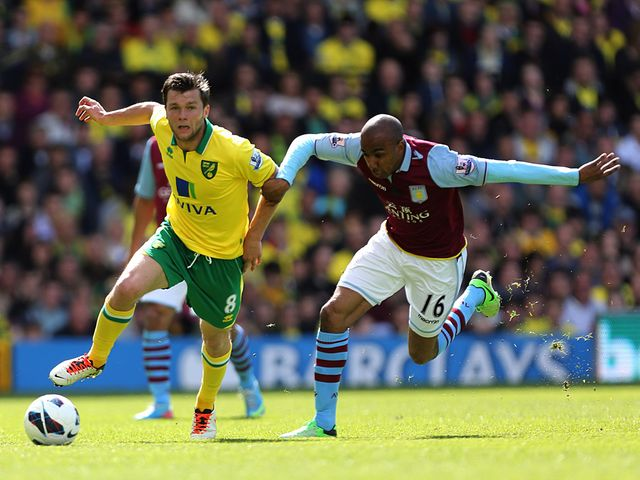 Jonathan Howson and Fabian Delph battle.