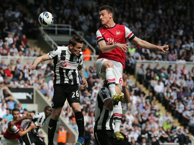Laurent Koscielny gets a header in.