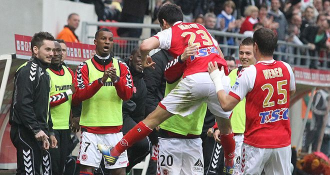 Aissa Mandi and Reims celebrate their leveller