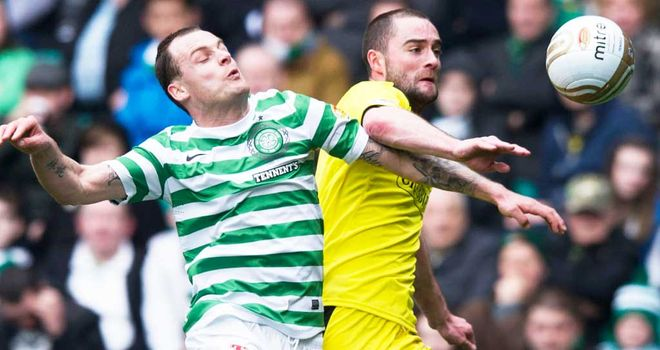 Anthony Stokes and James McPake: Duo lock horns in previous meeting between Celtic and Hibs