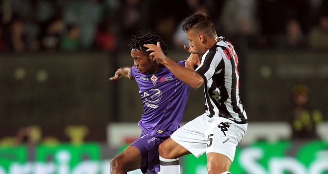 Adrian Calello fights for the ball with Juan Cuadrado.