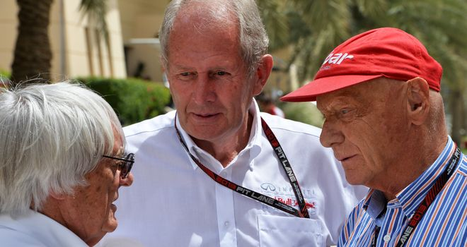 Helmut Marko (centre) speaks with Bernie Ecclestone (left) and Mercedes' Niki Lauda (right)