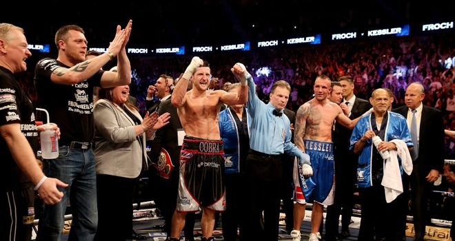 Carl Froch: Celebrates the verdict after hearing he has beaten Mikkel Kessler on points