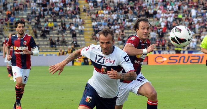 Daniele Portanova and Alberto Gilardino compete for the ball