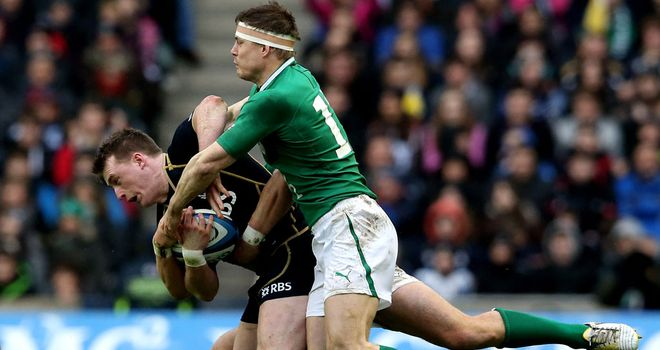 Stuart Hogg and Brian O'Driscoll tangle during this year's Six Nations campaign