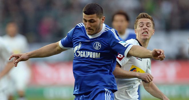 Patrick Herrmann and Sead Kolasinac tangle.