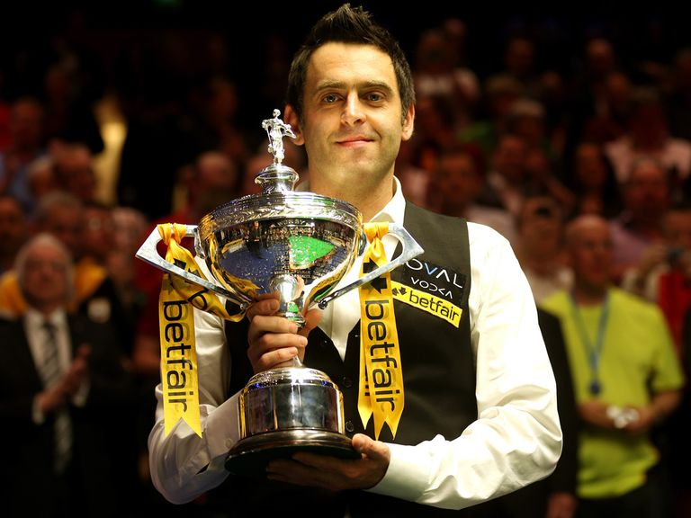 Ronnie O'Sullivan celebrates with the World Snooker Championship trophy.