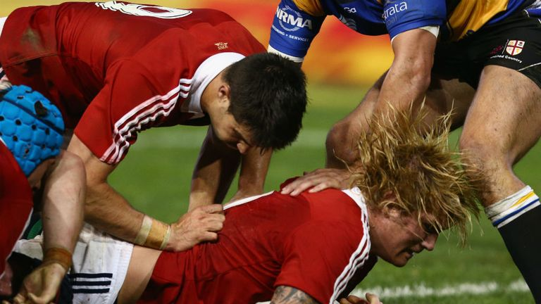 Richard Hibbard scores a try against Combined Country XV