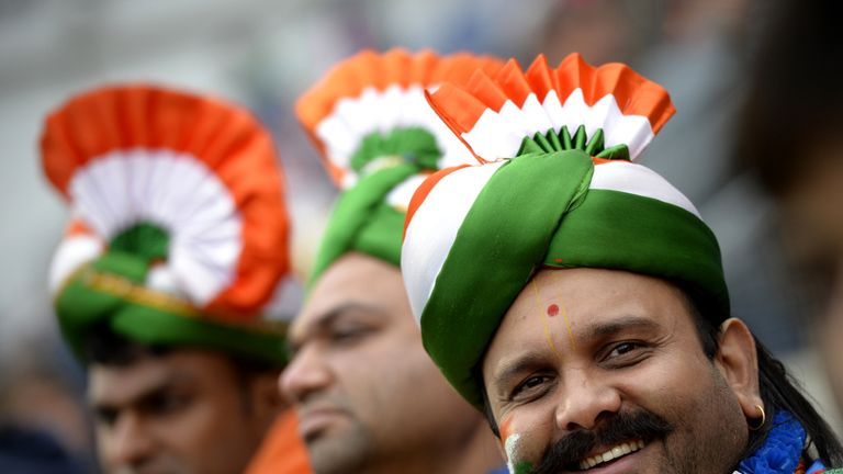 India fans had to wait a while as rain delayed the start.