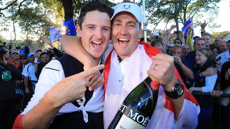 Justin Rose (l) and Ian Poulter celebrate last year's Ryder Cup victory at Medinah