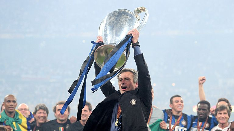 Mourinho lifts the Champions League trophy after Inter's 2-0 success over Bayern Munich in 2010