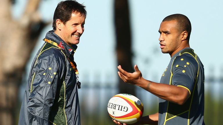 Will Genia: Speaks to Robbie Deans during Australia training