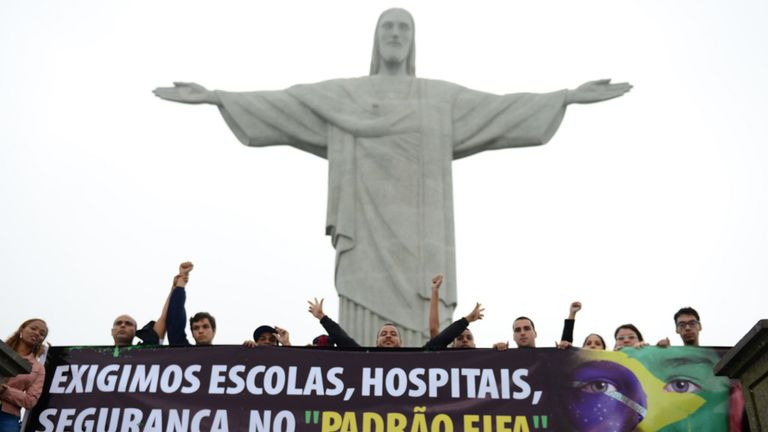 Protesters at the Statue of Jesus Christ the Redeemer in Rio during last summer's Confederations Cup