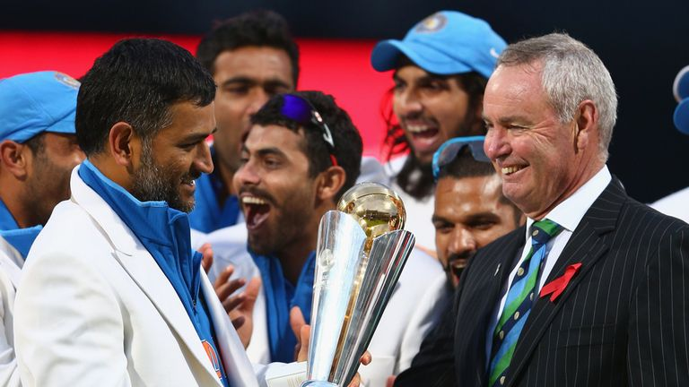 MS Dhoni collects the trophy after his side's five-run victory in the final