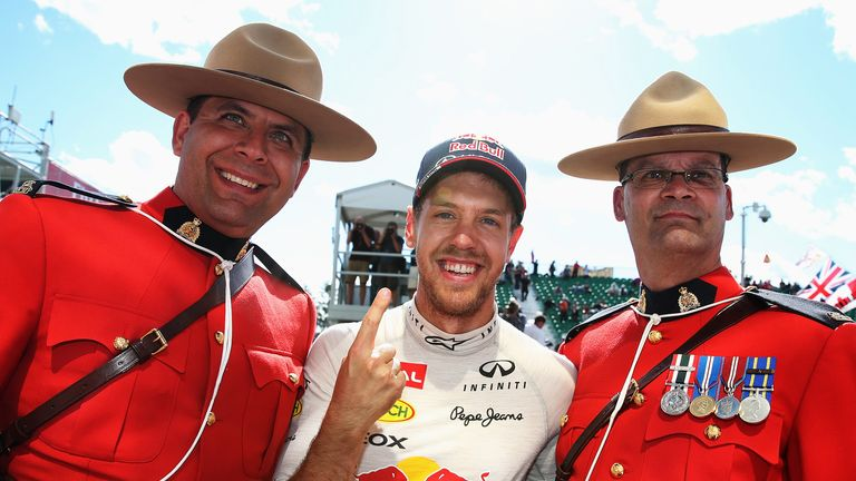 Sebastian Vettel: Celebrates his GP win with two Canadian Mounties