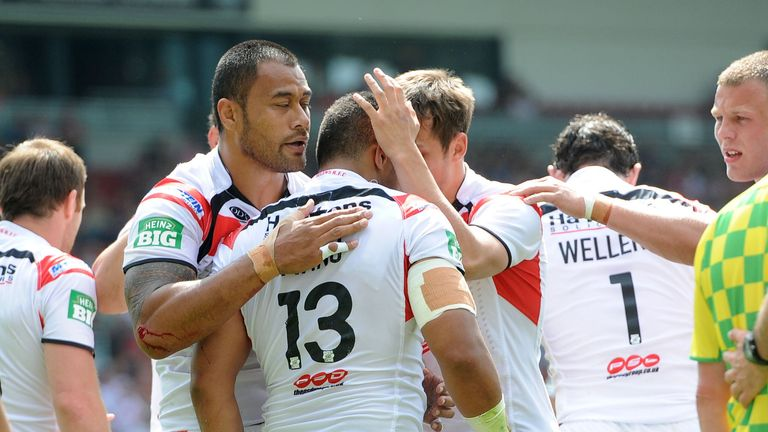 Willie Manu is congratulated by St Helens team-mates after scoring his try