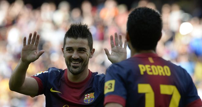 David Villa (left) opened the scoring for Barca