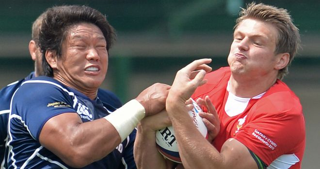 Takashi Kikutani tackles Dan Biggar during Wales' win over Japan last week