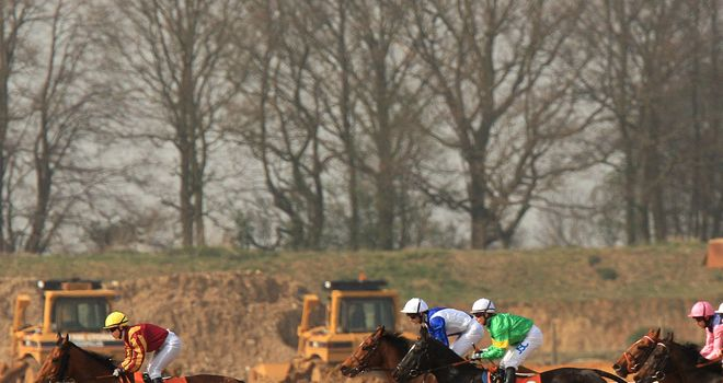 Racing takes place in front of construction equipment at Great Leighs