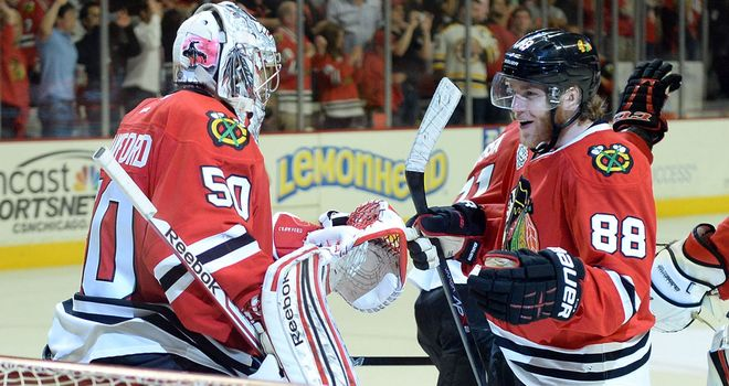 Patrick Kane celebrates with Chicago team-mate Corey Crawford